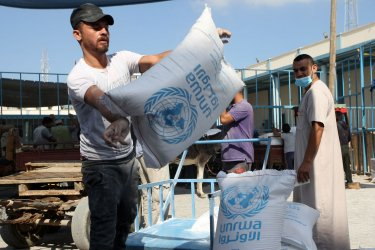 Palestinian Refugees Receive Aid Distributed by UNRWA in Gaza