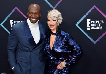 Terry Crews and Rebecca King-Crews attend the 44th annual E! People's Choice Awards in Santa Monica, California