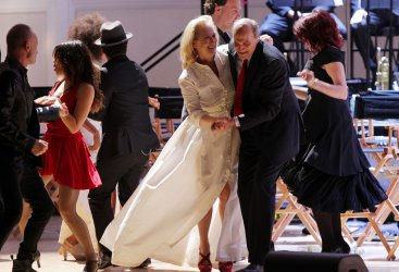 Meryl Streep and James Taylor dance on stage at the Revlon Concert for the Rainforest Fund at Carnegie Hall in New York