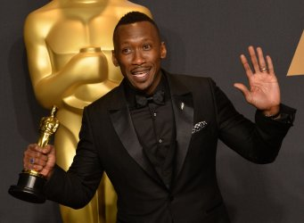 Actor Mahershala Ali  appears backstage with his Oscar at the 89th annual Academy Awards in Hollywood
