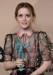 Claire Foy wins an award at the 23rd annual SAG Awards in Los Angeles