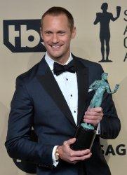 Alexander Skarsgard wins an award at the 24th annual SAG Awards in Los Angeles