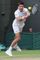Novak Djokovic returns in his fourth round match against Ugo Huberti at Wimbledon