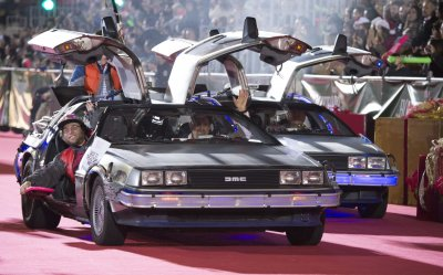 """Cars from """"Back to the Future"""" are seen in the 84th Annual Hollywood Christmas Parade in Los Angeles"""