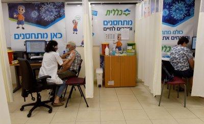 A Nurse  A Dose Of  A COVID-19 Vaccine In Jerusalem