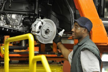 Chryler Worker Assembles Rotor part in Belvidere, Illinois