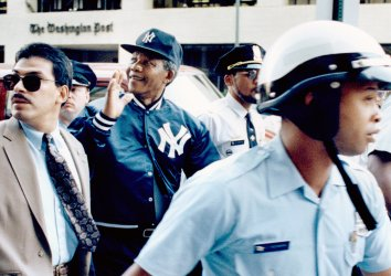 Nelson Mandela Stolling in Yankees Cap and Jacket