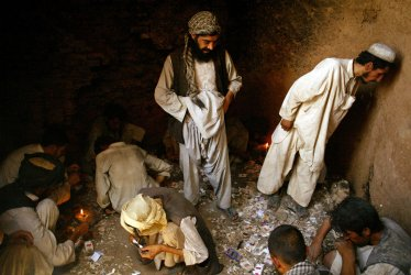 Heroin addicts smoke the drug in Afghanistan