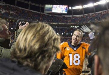 Broncos Manning waves after the 2016 AFC Divisional game in Denver