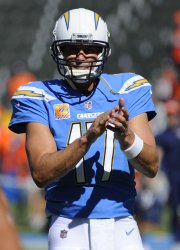 Los Angeles Chargers quarterback Philip Rivers claps during workouts before the game against the Broncos in Carson, California