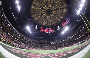 Fans use lights to honor military members during the National Championship