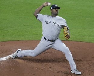 Yankees starter Severino throws in the first inning in the ALCS