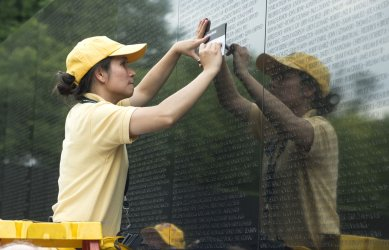 Americans Pay Their Respects at the Vietnam Memorial in DC