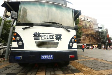 A Chinese police van is parked outside shopping centerin Beijing