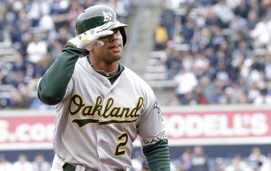 Oakland Athletics Khris Davis reacts after a home run