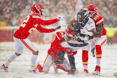 Broncos Courtland Sutton is tackled by Chiefs' Tanoh Kpassagnon, Juan Thornhill and Charvarius Ward