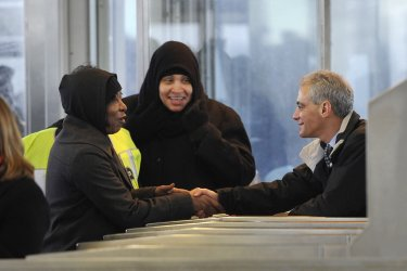 Emanuel shakes hands with commuters in Chicago