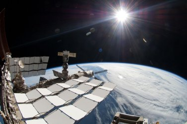 Sun, space station, Earth seen in May spacewalk