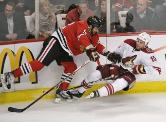 Blackhawks' Bollig checks Coyotes' Gordon in Chicago