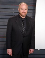 Louis C.K. arrives at the Vanity Fair Oscar Party in Beverly Hills