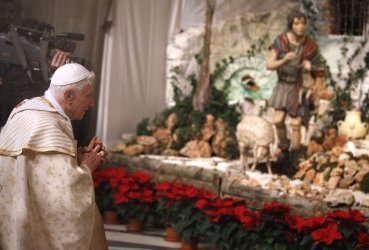 Pope Benedict XVI prays at the Nativity scene at the Vatican