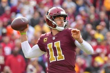 Redskins quarterback Alex Smith passes