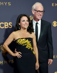 Julia Louis-Dreyfus (L) and Brad Hall attend the 69th annual Primetime Emmy Awards in Los Angeles