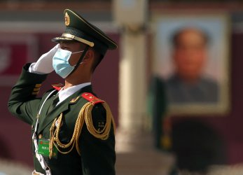 Soldier Wears Mask During The CPPCC Closing Session in Beijing, China