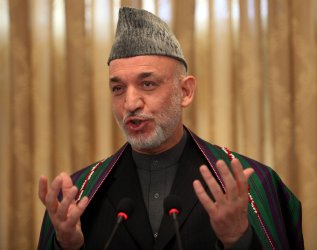 Karzai vows to eradicate corruption after winning new term in Afghanistan