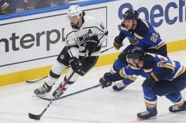 St. Louis Blues Alexander Steen and Kyle Brodziak pressure Los Angeles Kings Drew Doughty