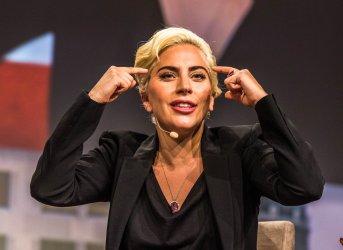 Dalai Lama and Lady Gaga at the United States Conference of Mayors