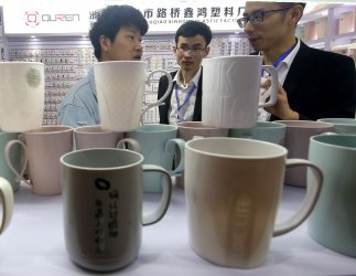 Potential buyers look at products at an e-commerce expo in Yiwu, China