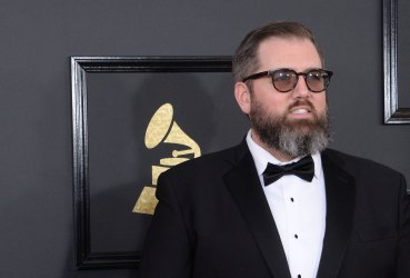 busbee arrives for the 59th annual Grammy Awards in Los Angeles