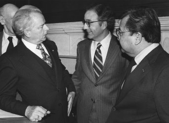 Senator Robert Byrd talks Senators George Mitchell and Daniel Inouye