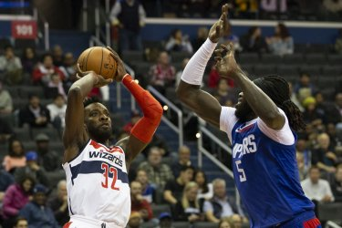 Washington Wizards forward Jeff Green shoots while defended by Los Angeles Clippers forward Montrezl Harrell