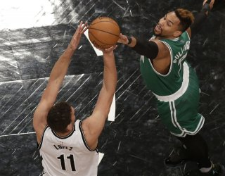 Nets Brook Lopez trys to block a shot from Boston Jae Crowder