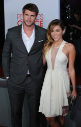 Miley Cyrus and Liam Hemsworth attend the People's Choice Awards in Los Angeles
