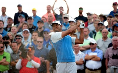 Tiger Woods tees off at Open Golf Championships