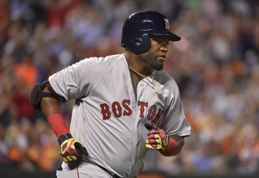 Boston designated hitter David Ortiz runs the bases after a 2-RBI home run against Baltimore