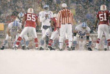Titans Vince Young in the snow against Patriots at Gillette Stadium in Foxboro, MA .