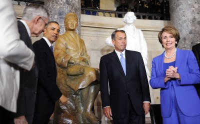 President Obama unveils a statue of Rosa Parks in the Capitol Building in Washington