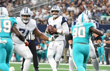 Dallas Cowboys Dak Prescott backs into the pocket against the Miami Dolphins