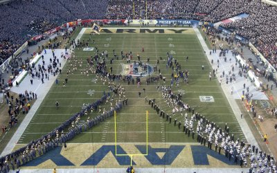 Army and Navy football plays take the field for the Army Navy game.