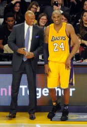 Los Angeles Lakers Kobe Bryant shares a laugh with coach Byron Scott