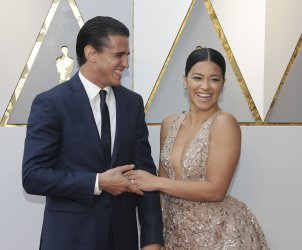 Joe LoCicero and Gina Rodriguez arrive at the 90th Annual Academy Awards in Hollywood