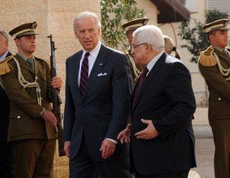 US Vice President Joe Biden and Palestinian President Mahmoud Abbas walk by a honor guard in Ramallah, West Bank