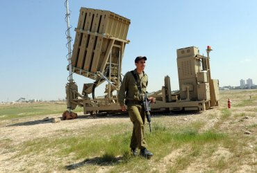 An Israeli soldier walks near the new Israeli anti-rocket system, the Iron Dome, in southern Israel