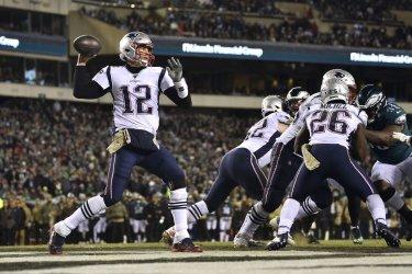 Patriots quarterback Tom Brady (12) throws the ball