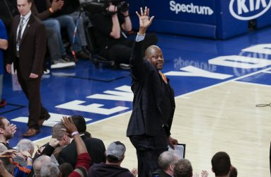 Charlotte Hornets assistant coach Patrick Ewing waves