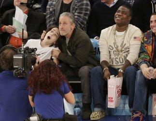 Jon Stewart and son Nathan Thomas Stewart watch the Knicks